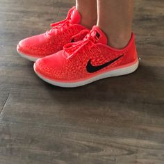 20f7a5af4b08c Shop Women s Nike Red Orange size Athletic Shoes at a discounted price at  Poshmark.