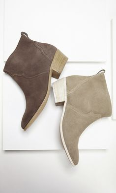 Suede western-inspired ankle bootie with a relaxed slip-on shape, stacked low heel and rear pull tab