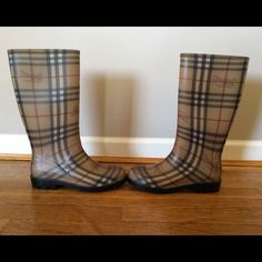 Burberry Rain Boots Good used condition. Only worn once. Small scuff on the left boot (last picture). No box. Offers welcome! Burberry Shoes Winter & Rain Boots