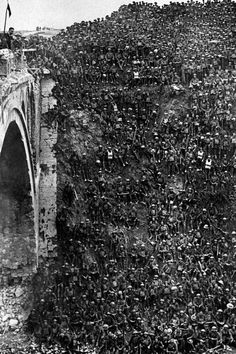 WWI: Brigadier- General J.V. Campbell (on bridge) congratulates soldiers of the 46th (North Midland) Division at Riqueval after their successful crossing of the St. Quentin Canal. - Found via Buzzfeed