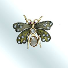 Butterfly brooch with rose-cut diamonds. Art Nouveau, early 20th Century, silver and 18 karat gold.