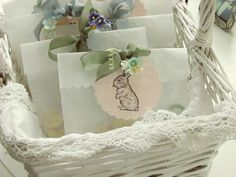 """***OMG, I love these!!!... """"glassine bags or the waxed paper sandwich bags  I used a scallop punch across the top of the bag and I punched out scalloped circles from patterned scrap booking paper.  Then I stamped a bunny and tied it all up with some rayon seam binding and a sprig of paper flowers."""""""