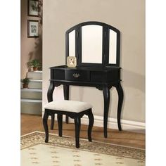 Maren black finish wood bedroom makeup vanity with tri-fold mirror and stool. This set includes the vanity table, tri fold mirror and stool. Vanity measures x x H, Stool measures x x H. Mirror measures x H. Wood Makeup Vanity, Bedroom Makeup Vanity, Wooden Vanity, Vanity Desk, Vintage Vanity, Makeup Stool, Bedroom Vanities, Black Vanity Set, Vanity Set With Mirror