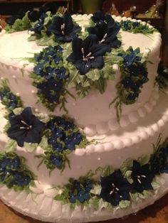 Wedding Cake with white background and dark blue flowers, June's Bakeshop, New Braintree MA