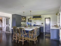 An eclectic yet classic kitchen with a moody blue palette.