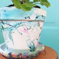 Create a beautiful, marbled flower pot using nail polish!