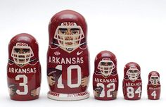 5 piece matryoshka doll set, featuring different famous Arkansas Razorbacks football team players. This set is made by hand in Russia. It is made of linden wood and then painted by a professional matr