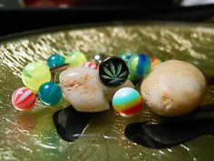 Tongue Ring Lot. Marijuana Leaf and accessories!  This is the actual set you will receive. . Set includes all you see in photos.  All brand new and packaged individually   14g 316L Surgical Steel. Acrylic accents. * Body Jewelry is not returnable. But you are eBay buyer protected:)