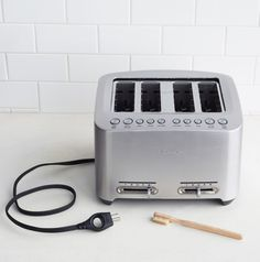 Use an old toothbrush to clean the inside of your unplugged (safety first!) toaster.