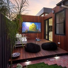 This modern extension to an Art Deco house in Melbourne, Australia features an indoor/outdoor cinema.