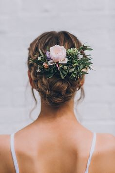 Bridal updo with floral hairpiece   Image by Matt Horan Photography