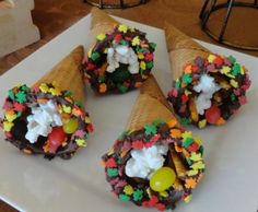 """""""Charlie Brown Thanksgiving"""" Ice Cream Cone Cornucopias. Inspired by Snoopy's feast of popcorn, pretzel sticks & jelly beans. Serve when watching """"A Charlie Brown Thanksgiving"""" or make with kids as part of a themed activity with the movie."""