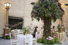 Ashland Addison Florist brought in a giant prop tree for its whimsical lounge area. The tree was decked with mechanical butterflies that could move their wings.  Photo: Carasco Photography
