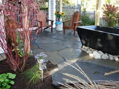 Stonemasons and contractors Dean Marsico and Derek Stearns transform blah backyards into functional living spaces.