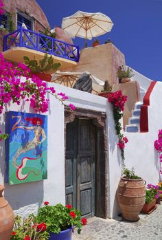 Door entrance in Oia, a picturesque village of Santorini, Greece. Who comes up with these color palates? Is there a commission of some kind that is responsible for the standard? Individual property owners? No matter, I guess, as the result is stunning!!