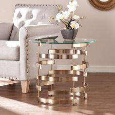 Enhance the look of your contemporary living room with this divine Harper Blvd end table. Shiny champagne base has an open, interlocking design full of airy negative space. Tempered glass top blends w
