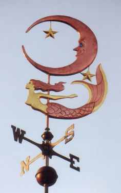 Our Mermaid with Wavy Tail Weather Vane is one of our most popular mermaid designs. The mermaid weathervane shown here was handcrafted with optional gold leaf on Mermaid Artwork, Weather Vanes, Mermaids And Mermen, Merfolk, Stars And Moon, Sea Creatures, Whimsical, Arts And Crafts, West Coast