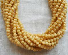 Fifty 3mm Antique Beige melon beads, neutral Czech pressed glass beads C8550