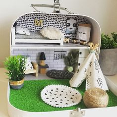 Monochrome house is completeThis is an example of a standard suitcase doll house perfect for boys and girls. These can be adapted in so many different ways including personalised details so they can take their special little home on their travels  little_lucciola