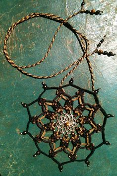 Macrame mandala with tiger eye for courage, inner strength & divine will