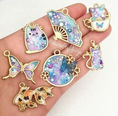 Here are the other Galaxy (and one gold flake koi hehe) bezels that will be available in tomorrow's Etsy shop - Salvabrani Kawaii Jewelry, Kawaii Accessories, Cute Jewelry, Diy Jewelry, Jewelery, Jewelry Making, Uv Resin, Resin Art, Mode Kawaii