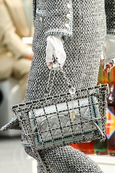 Leather and chain shopping basket carrying a quilted Chanel handbag at Chanel AW14 PFW. More images here: http://www.dazeddigital.com/fashion/article/19141/1/top-ten-aw14-details
