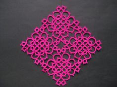 Square tatting doily, tatted with fuchsia acrylic thread, from a free tatting pattern.