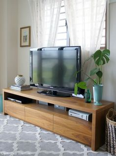 FARMHOUSE- TV stand used to be one of the most important home decorations. It was filled with smaller furniture to complete the look of the room. Commonly, the old-antique design of TV stand involv… Tv Stand Decor, Diy Tv Stand, Long Tv Stand, How To Decorate Tv Stand, Cheap Tv Stand, Simple Tv Stand, Tv Cabinet Design, Tv Rack Design, Booth Design