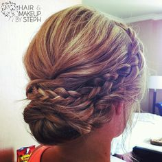 Braided of the side into the bun!! Beautiful!