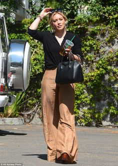 Glam: Duff polished off the business casual look with an assortment of eye-catching bracel...