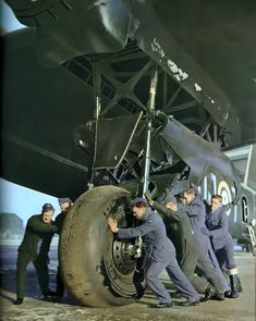 RAF aides try to remove a wheel landing gear of this huge heavy bomber Short Stirling. This was one of the biggest bombers of the war and the second in capacity.When it became obsolete over other as the Lancaster, I modified it to make transport glider. Ww2 Aircraft, Military Aircraft, Image Avion, Lancaster Bomber, Ww2 Planes, Royal Air Force, Stirling, Military History, World War Two