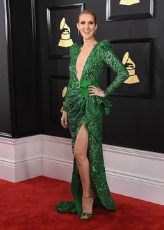 Dion was radiant in a dazzling green Zuhair Murad dress at the 59th Annual Grammy Awards. The look was everything we have come to love from the star from the plunging neckline to a thigh high slit. 2017.