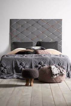 I'm not a fan of the headboard, but I love the bedspread and the knitted cushions.
