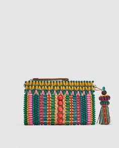 MULTICOLOURED BRAIDED CLUTCH 89.99
