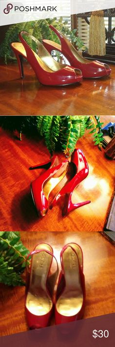 Guess by Marciano Candy Apple Red Patent Heels So Pretty/Super Sexy!!!.. Candy Apple Red Patent with a Gold Foot bed... Peep toe/sling back with elastic for comfort. These are New never been worn, there are a few marks on the gold lined foot bed does not take from this beautiful shoe, see pix 3 &7. Heel is 4-1/2 inches, with a hidden Platform of just over 1/2 inch. I do not have the box. If your searching for a certain color shoe just ask me... I have a closet full.... Love my heels!!! Guess…