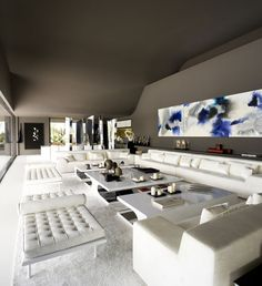 A-cero Projects. Modern living room. White furniture, lovely dark wall and celling.