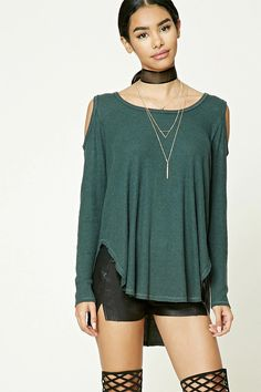 A ribbed knit top featuring an open-shoulder design, long dolman sleeves, a round neckline, and a dolphin hem.