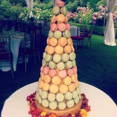 Macaron Tower made of pistachio, passion fruit and raspberry macarons.