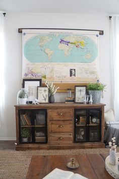 Brilliant solution for disguising and hiding a TV...a vintage pull-down map! // featured on Home Love Stories (click through for more details and photos of this beautiful room)