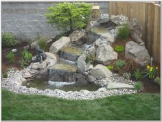 Small Waterfall Sloped Backyard Landscaping Ideas On Waterfall Landscaping Design Waterfall Landscaping, Garden Waterfall, Pond Landscaping, Small Waterfall, Waterfall Design, Sloped Backyard, Backyard Water Feature, Ponds Backyard, Backyard Ideas