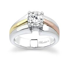 Tri Color Solitaire Engagement Ring - 7302LTW - A statement of strength and clarity radiates from this tri-color gold solitaire ring. The white gold shank features a prong set diamond center resting just above the cathedral shoulders.  The bright polished wide tapering shoulders are accented with a yellow gold band running down the shoulder on one side, and a rose gold band on the other side for an added touch of intrique.  Also available in two-tone, all white or yellow gold, 18k and…