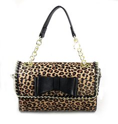 Betsey Johnson Handbag BE MY WONDERFUL MINI SATCHEL Leopard BlackBoth  stunning and versatile it's impossible to not love this bag. Softly structured with a go-anywhere attitude this Betsey mini satchel hits a high note for work or weekend. Topped with sturdy handles and an optional crossbody strap offers carrying convenience. •Faux leather •Magnetic-snap flap closure •Dual carrying handles; removable adjustable crossbody strap •Whipstitch chain link trim with adorable bow at ...