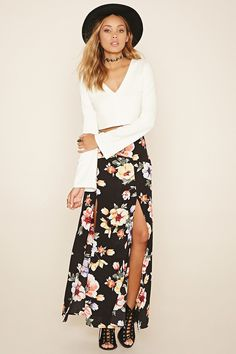 A woven maxi skirt featuring an allover floral print, an M-slit hem, and a concealed side zipper.