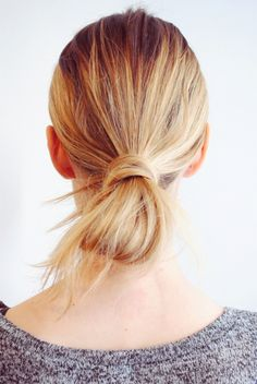 Wrapped low bun hairstyle: http://www.stylemepretty.com/living/2016/04/05/second-day-hair/