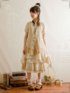 Japanese Mori Girl Fashion. Patterned material, lace trimming, cream and off white colours, light pink tones, layers of fabric.