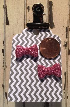 Dainty Glittered Bow-tie earrings. post only by RockinRobinsBling