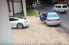 WATCH: QUICK-THINKING PORSCHE DRIVER BUMPS HIJACKERS' CAR AND GETS AWAY