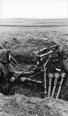 MG 42 in schweres mashinengewehr (sMG or heavy MG) role & three panzerfausten M60 in trench or firepit