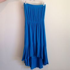 🎉HOST PICK🎉Dress Super cute high-low, 100% rayon dress. This can be worn as a dress or a swim cover-up. The color is a bright turquoise. Washed once, never worn. Great condition!!!🐬 Coco Bianco Dresses High Low