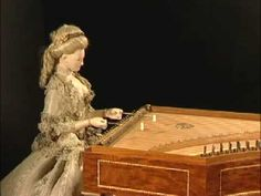 "This is an automaton made for Marie Antoinette around 1780, it is made from her clothing and hair.    The beautiful automaton is named  ""La Joueuse de Tympanon"", or ""The Dulcimer Player"". She can play eight different songs by changing the disc beneath the costume.    After the revolution, she was badly damaged, but repaired in the 1800's and now resides in a museum in France."